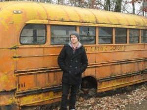 That is me next to a dirty, old school bus.
